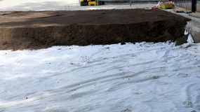 Securing soil contamination by PAHs on the grounds of a school b. Y applying a geotextile, contaminated site Royalty Free Stock Photos