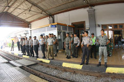 Securing station. Police guard the train station after a clash between the merchant and the security officer station in the city of Solo, Central Java, Indonesia Royalty Free Stock Photos