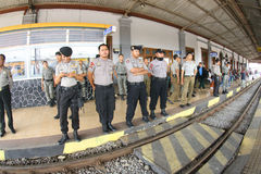 Securing station. Police guard the train station after a clash between the merchant and the security officer station in the city of Solo, Central Java, Indonesia Stock Image