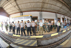 Securing station. Police guard the train station after a clash between the merchant and the security officer station in the city of Solo, Central Java, Indonesia Stock Photography