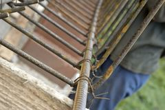 Securing steel bars with wire rod for reinforcement of concrete or cement. Stock Photography