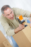 Securing and taping box Stock Photo