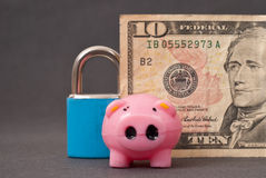 Securing Your Finances. With Little Piggy And A Lock Stock Images