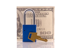 Securing Your Finances. With Money, Lock And Key Royalty Free Stock Photo