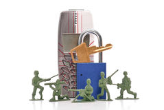 Securing Your Phone Line. With Army Men And Padlock Stock Images