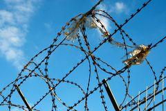 Security. A tall security Fence blocks access Stock Images
