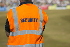 Security. Marshall at sports event looks over proceedings Stock Images