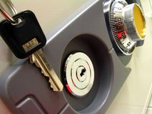 Security. Combination and key lock of an office safe Stock Photos