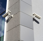 Security. Cams attached on corner of the building royalty free stock photo