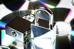 Security. Concept data security with padlock on CD disc Royalty Free Stock Photos