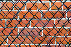 Security- brick wall and fence Stock Photos