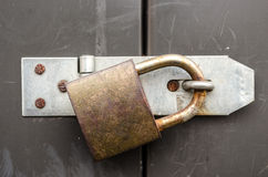 Security. Iron lock and chain on an old door Royalty Free Stock Images