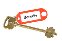 Security. A key with a security label isolated on white Royalty Free Stock Image