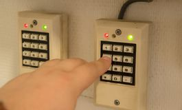 Security alarm system. Double keypad from home alarm security sistem. Hand pressing buttons Stock Photography