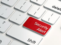 Security alert computer key. Security alert label in red color on a computer keyboard key, showing IT security concept Stock Image