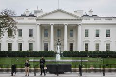 White house border security, overcast. Security around the white house stand guard on an overcast day. Rear of the White House historic landmark in Fall 2018 stock image