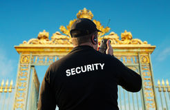 Security. Back of security guard in front of gate royalty free stock image