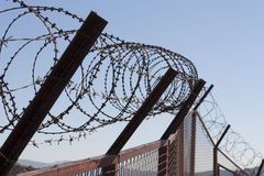 Security with a barbed wire fence. Protection concept design. Royalty Free Stock Images