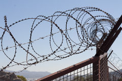 Security with a barbed wire fence. Protection concept design. Stock Image