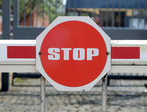 Security barrier. Detail of transport security barrier with stop sign Stock Image