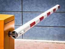 Security barrier. Modern security barrier at a garage - nice background Stock Photography