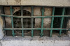 Free Security Bars On A Basement Window Royalty Free Stock Image - 185699226