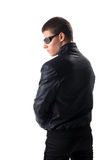 Security in black leather jacket and glasses Stock Photo