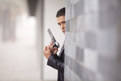 Security Businessman with a handgun. Powerful security businessman aiming a gun royalty free stock image