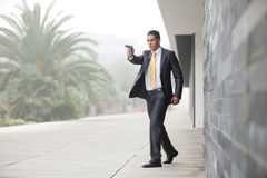 Security Businessman with a handgun. Powerful security businessman aiming a gun royalty free stock photos