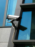 Security cam. On modern building stock photos