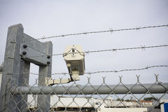 Security cam overlooking truck yard. With chainlink fence and barbed wire Stock Photography