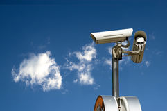 Security camera. On the blue sky background Royalty Free Stock Images