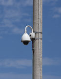 Security camera. Outdoor security camera on a lighting pole Stock Image