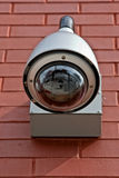 Security camera. On the outside building's wall stock image