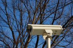 Security camera. A security cam with a blue sky background Royalty Free Stock Photos