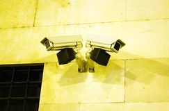 Security camera. Night shot of security cameras on the wall Stock Images