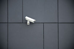 Security camera. On dark modern building Royalty Free Stock Photos