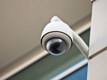 Security Camera. High tech overhead security camera at a government owned building Stock Photography