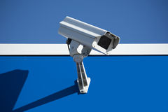 Security camera. Security surveillance camera on the side of an industrial building Stock Images