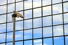Security camera. On front of glass building stock image