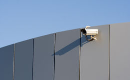 Security camera. On a wall stock photography