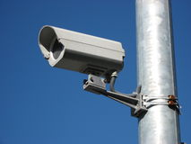 Security camera. Outdoor security monitoring camera, placed on the metallic tube Stock Photos