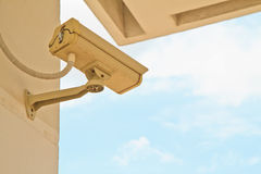 Security camera. CCTV security camera at home and blue sky stock photo