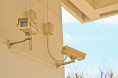 Security camera. CCTV security camera at home and blue sky royalty free stock images