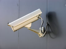 Security camera. Closeup of a white generic security camera on the wall. No RAW image available Royalty Free Stock Images