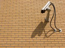 Security Camera. On a brick wall pointed downwards Royalty Free Stock Photo