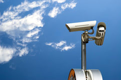 Security camera. On the blue sky background Stock Image