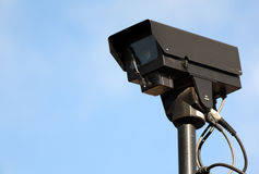 Security camera. Cctv security camera against blue sky Stock Image