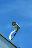 Security camera against blue sky Stock Image