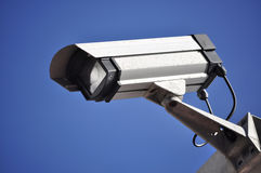 Security Camera against blue sky. Watching over the happening of cape town city Royalty Free Stock Photography